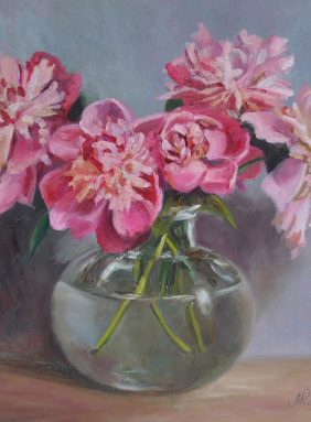 """Peonies in a glass vase"""